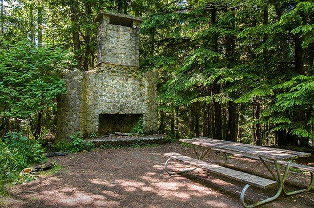 One of the lesser-known landmarks in Squak Mountain State Park is the Bullitt Chimney.  This is all that remains of the Bullitt family farm that once stood on this site.  (Washington State Parks)